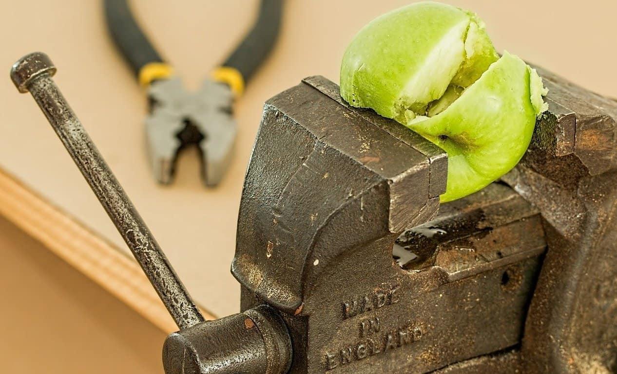 vice crushing an apple